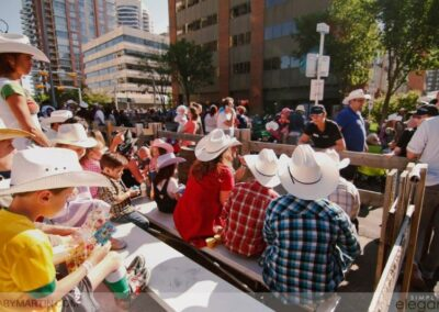 Calgary Stampede events planning services - group watches parade passing by