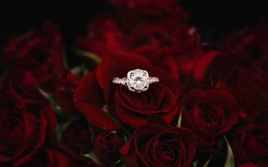 Engagement ring on red roses