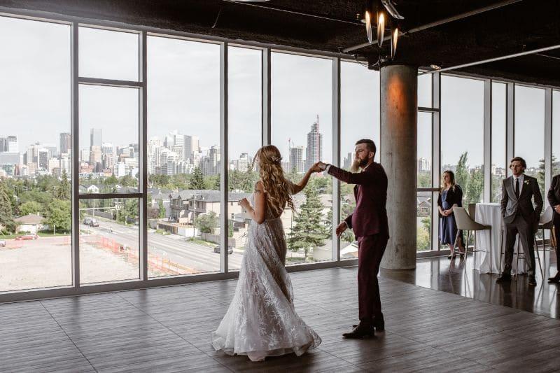 Wedding planner at Skyline Room Calgary - bride and groom dancing